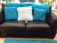 Brown 2 seater sofa and armchair.