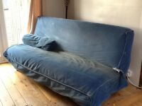 Sofabed, storage underneath, & cushion in blue cord
