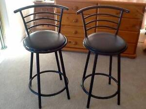 Two black metal bar stools with  swiveling tops.  good condition Stanwell Park Wollongong Area Preview