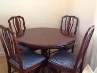 Mahogany table and chairs in excellent condition