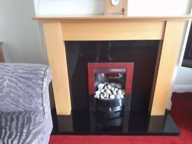 GAS FIRE WITH BLACK MARBLE HEARTH AND MAPLE SURROUND