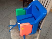 Portable/travel booster seat for dining chairs -has straps to go underneath and around back of chair