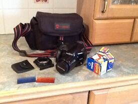 Camera, camera bag, two filters and fitting and some films.