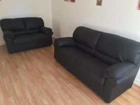 Black leather 2 plus 3 seater sofa set ex display should be £449 but on offer for only £299