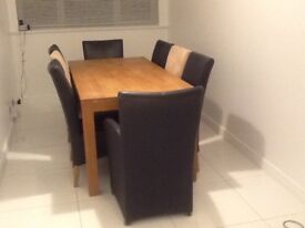 Dining table (light oak) measures 180 x 90 cm and 8 chairs (2 carver)