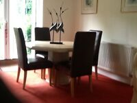 Dining room suite - Beige marble table and 4 brown leather chairs