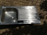 New and unused stainless steel sink. Right hand drainer.