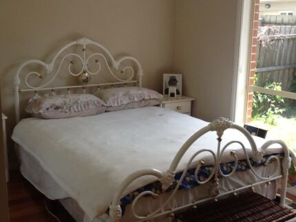 Queen bed Sleepmaker mattress and base with white cast iron frame
