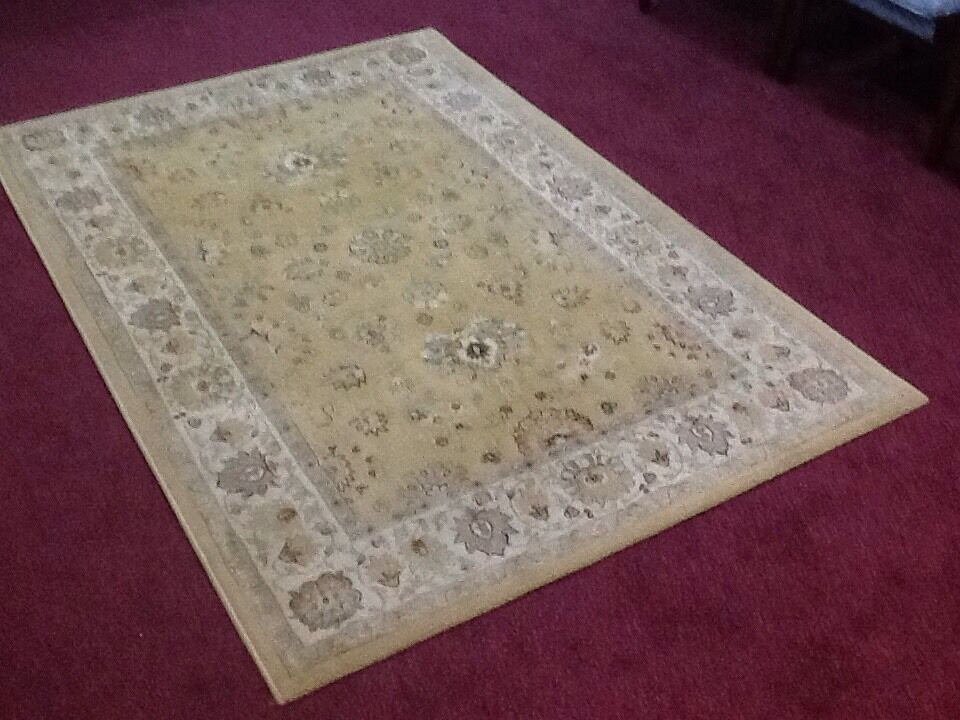 """Medium size Indo Persian """"Agra"""" 100% wool rugin Kimberley, NottinghamshireGumtree - Medium size Indo Persian 100% wool rug in an """"Agra"""" design, principal colours being gold/beige. In good condition, no marks, stains, wear or fading this has recently been thoroughly cleaned. Measures 132cm x 195cm.£35"""