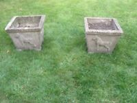 two nicely weathered masonry plant pots can deliver