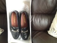 A pair of ladies Russell and Bromley shoes