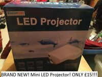 Brand New! Mini LED projector. Yellow!