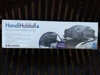 Handiholdhall folding roofbox folds small to fit in the boot not been used
