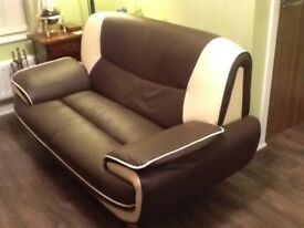A matching two and three seater sofa