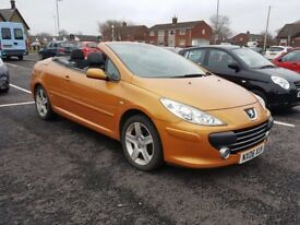 Peugeot 307cc in gold/orange