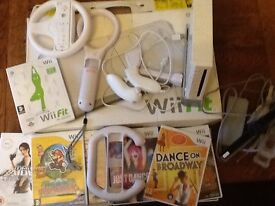 Wii plus wifi fit board 1 remote and various games