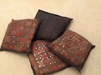 All 4 cushions cover with lovely red,brown embroidery,mirror work with zip, £4 for all.