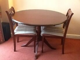 Pedestal mahogany dining room table and 2chairs, very good condition.