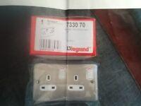 Legrand twin chrome sockets.