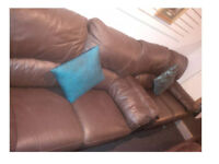 REDUCED.....2 X 2 SEATER BROWN LEATHER RECLINING SOFAS VERY COMFY AND NICE DESIGN £129.99 PAIR