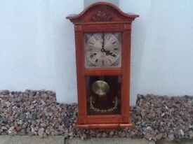 Wooden chiming wall clock with wind up key