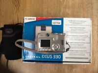 CANON DIGITAL CAMERA,box, instructions battery and charger and case.