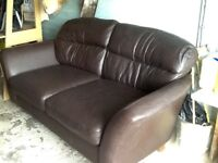 2brown leather sofas