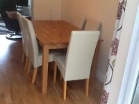 Oak finish dining table + 6 chairs