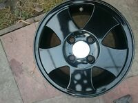 Black 14 inch ford alloy wheels