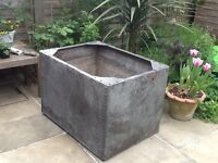 Lovely large vintage riveted water tank. Would make a great large planter. Has drainage holes.