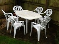 6 seater plastic garden furniture with cushions, table cloth and umbrella.