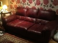 3 seater wine coloured leather settee. 2 years old