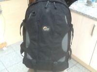 £40-Lowe Alpine Shuttle 65 litre capacity clam shell opening travel rucksack-has side carry handles