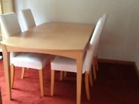 Light wood dining table and 4 chairs with cream washable cotton covers