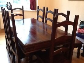 Dining table + 8 chairs, coffee table, 2 side tables and a set of drawers