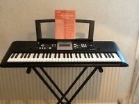 Yamaha Electronic Keyboard model number PSR E223, as new condition with stand and Excellent sound.