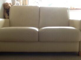 2 settees, 1 three seater and 1 two seater beige leather contemporary design with light feet