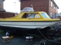 cabin fishing boat with trailer and outboard
