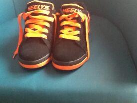 Heelys , black and orange, size 4, excellent condition, one wheel