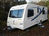 2011 Bailey Pegasus Verona with `U`shape living area and fixed bed. Rear end wash room