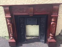 Antique cast iron fireplace with attractive wood surround, can be sold separately.