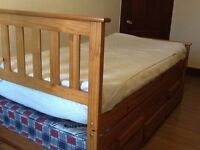 Pine single captains bed with bed underneath and Three drawers.