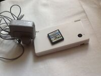 Nintendo dsi with game and charger