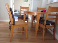 Solid wood round drop leaf table and 4 chairs
