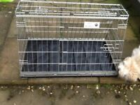 dog cage for car boot, sloping, shaped to fit behind rear seat.