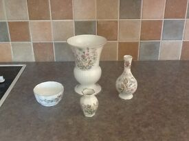 Four pieces of Aynsley fine bone china