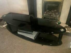 Black glass tv unit.