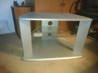 silver tv stand with glass shelf.
