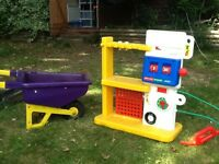 Toddlers petrol station and wheelbarrow