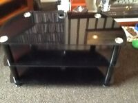 Black glasss TV stand with 2 shelves